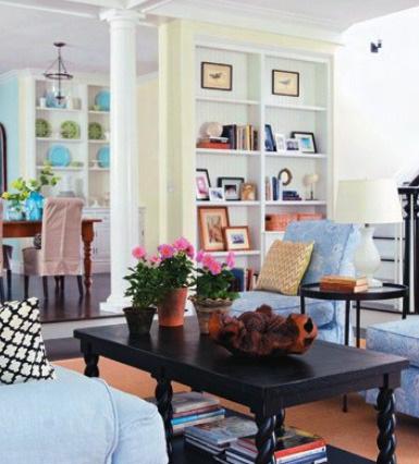 黑色元素——矩形咖啡桌,金属边桌,黑白花纹靠包给客厅里的色调增